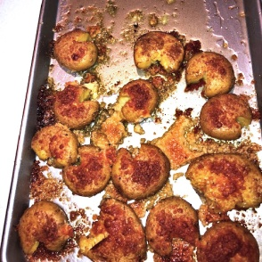 Herbed golden brown potatoes on a baking sheet