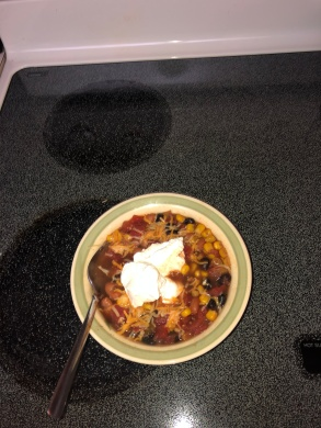 Bowl of Mexican Soup topped with cheese and sourcream