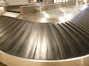 an empty baggage claim conveyor belt at an airport