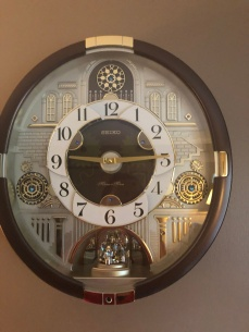Analog wall clock at 9:15